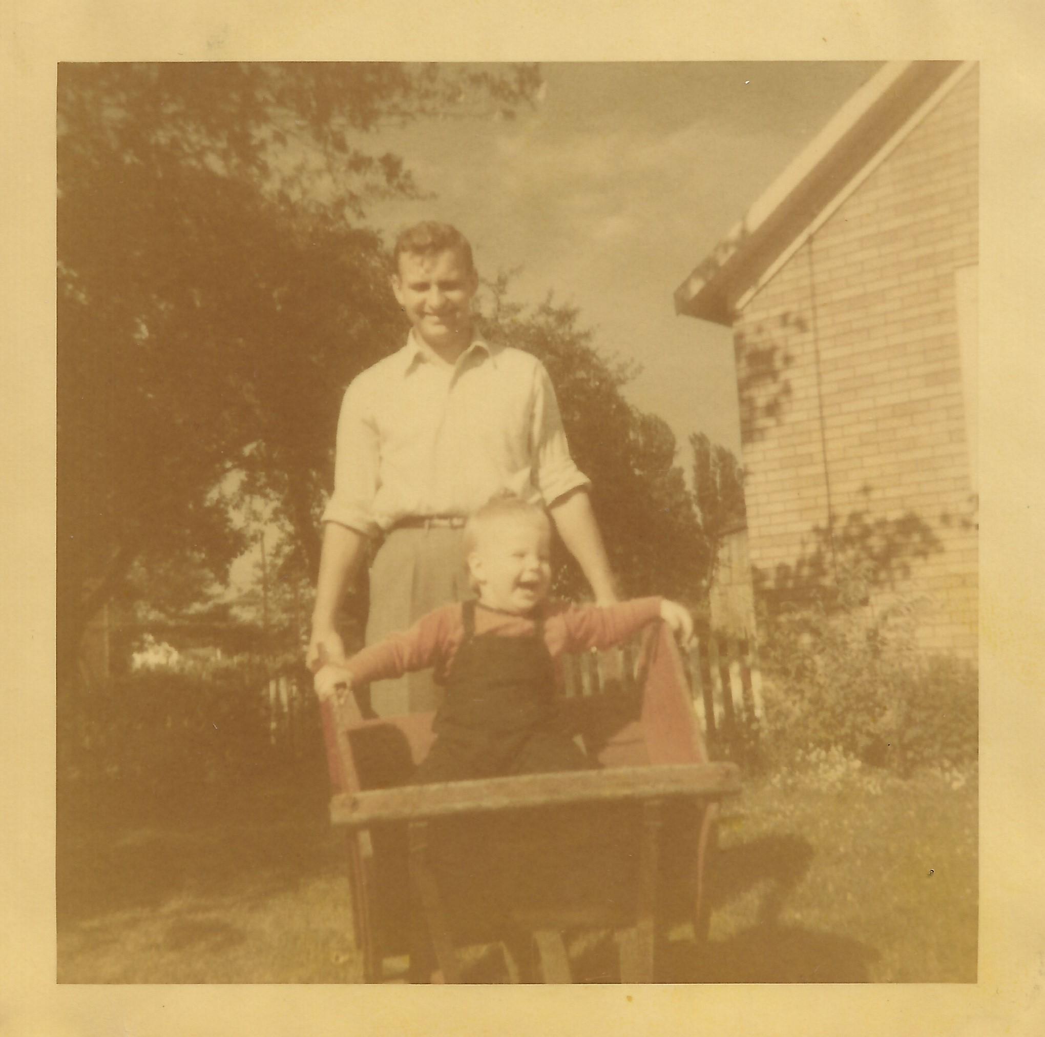 Becky and Dad wheelbarrow fixed